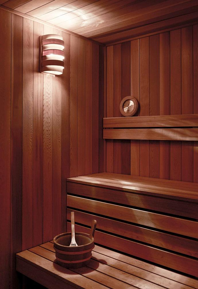 "**Sauna** Angela and Michael engaged an old-school sauna maker for this long-dreamt-of luxury, which is lined in cedar. Wall sconce, [Ross Gardam](https://www.rossgardam.com.au/|target=""_blank""