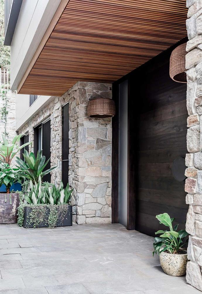 Stone cladding became a stunning visual feature of this home exterior. Photo: Maree Homer | Story: Inside Out