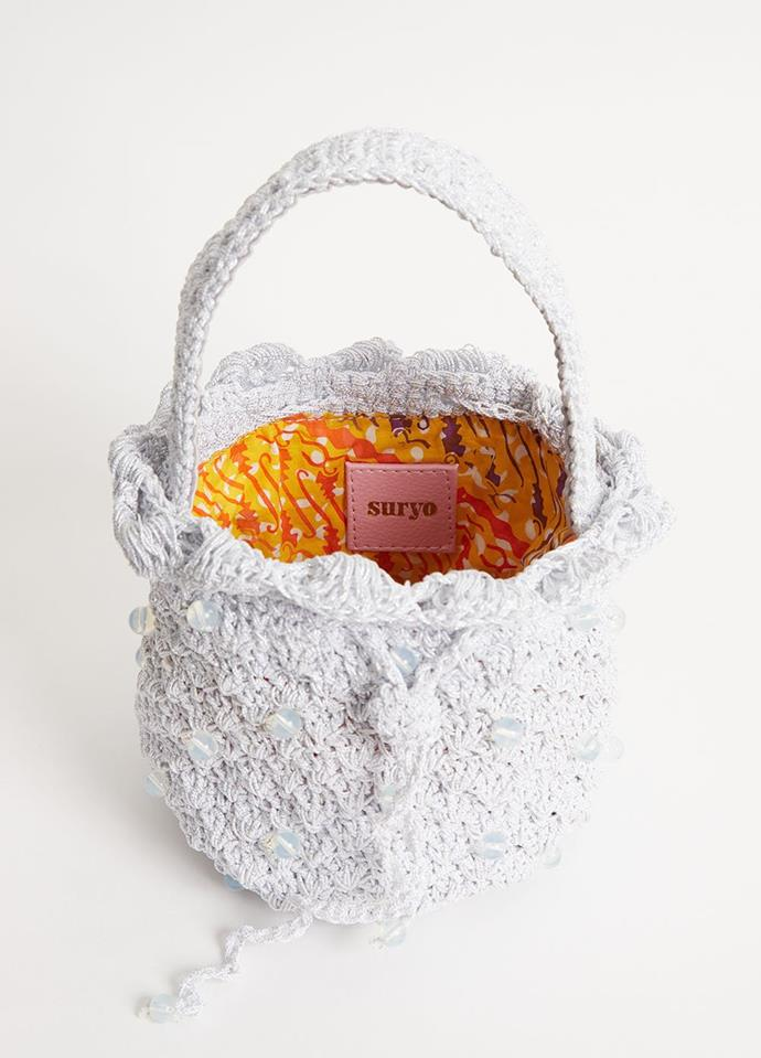 "Suryo Bucket Of Ice Bag, $330, [Incu](https://www.incu.com/products/suryo-bucket-of-ice-bag-snow|target=""_blank""|rel=""nofollow"")"