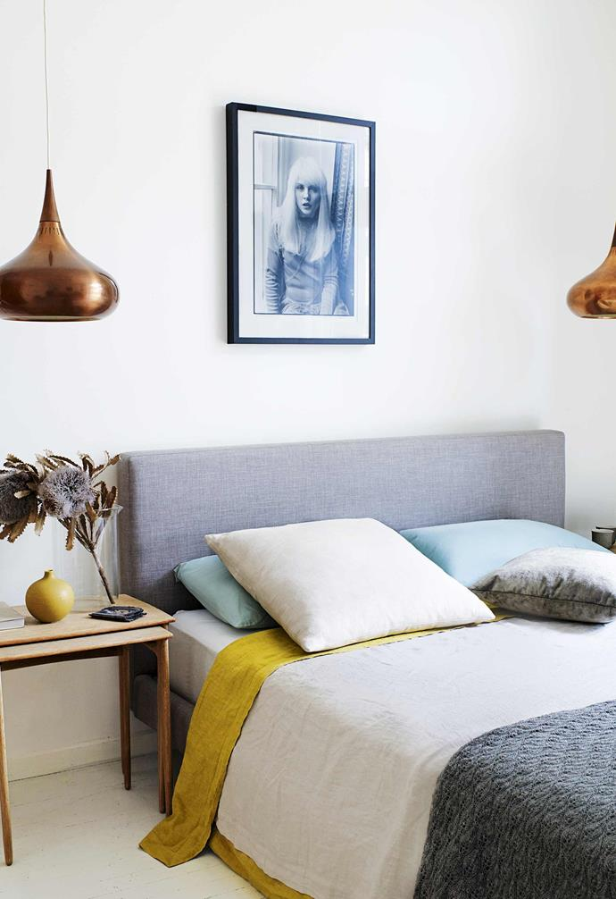"""""""I just painted everything in white [Dulux Antique White USA],"""" she says. """"I didn't have to do much else. It's now so light – it's like living in a light box.""""<Br><br>**Master bedroom** 'The Orient' copper lamps and timber nest tables from [Vampt Vintage Design](https://vamptvintagedesign.com/