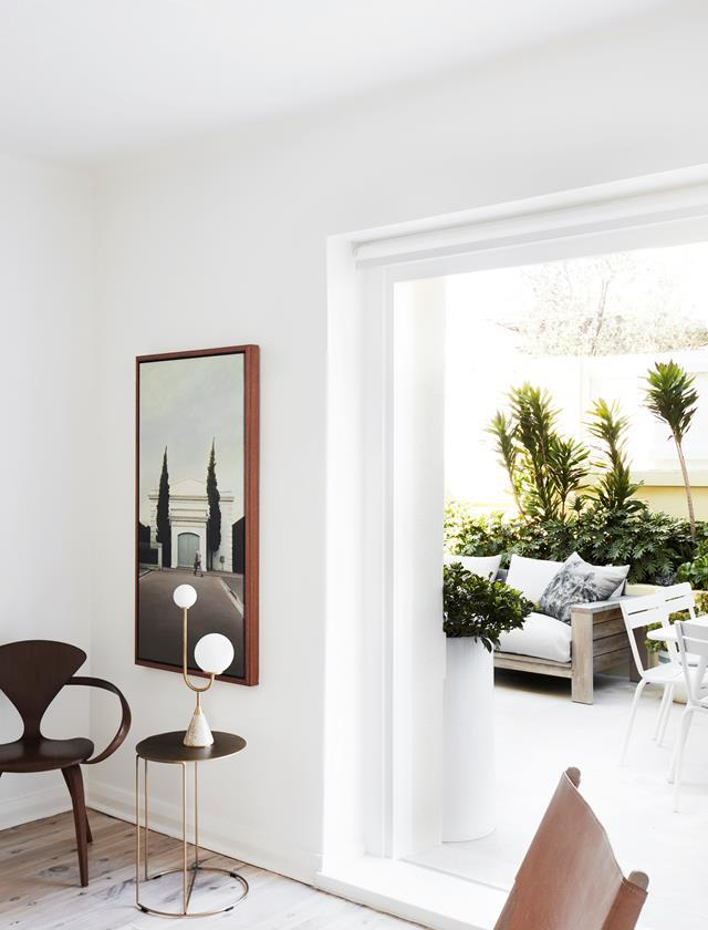 The dynamic duo behind Studio Quarters - Theresa Chan and Janice Chenchow - refreshed this North Bondi apartment while embracing its art deco character and beachside location. The living room flows through to the courtyard, where a Kerrie Brown cushion graces the existing outdoor lounge.
