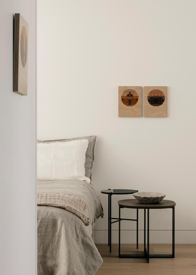 In the bedroom is an 'Antitesi' table by Ivano Redaelli paired with a Molteni&C 'Domino Next' side table. Artworks by Anika Cook of The Gently Unfurling Sneak.