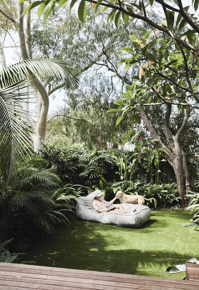"""Tropical plantings and a generous lawn space transformed the backyard of this [Bondi duplex](https://www.homestolove.com.au/duplex-home-renovation-19533