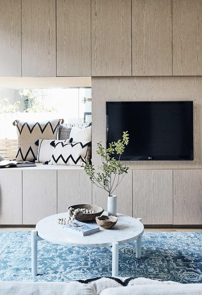 "A custom wall of cabinetry in the living room of this [Scandi-noir house](https://www.homestolove.com.au/scandi-noir-house-20344|target=""_blank"") helps to make the television feel right at home."