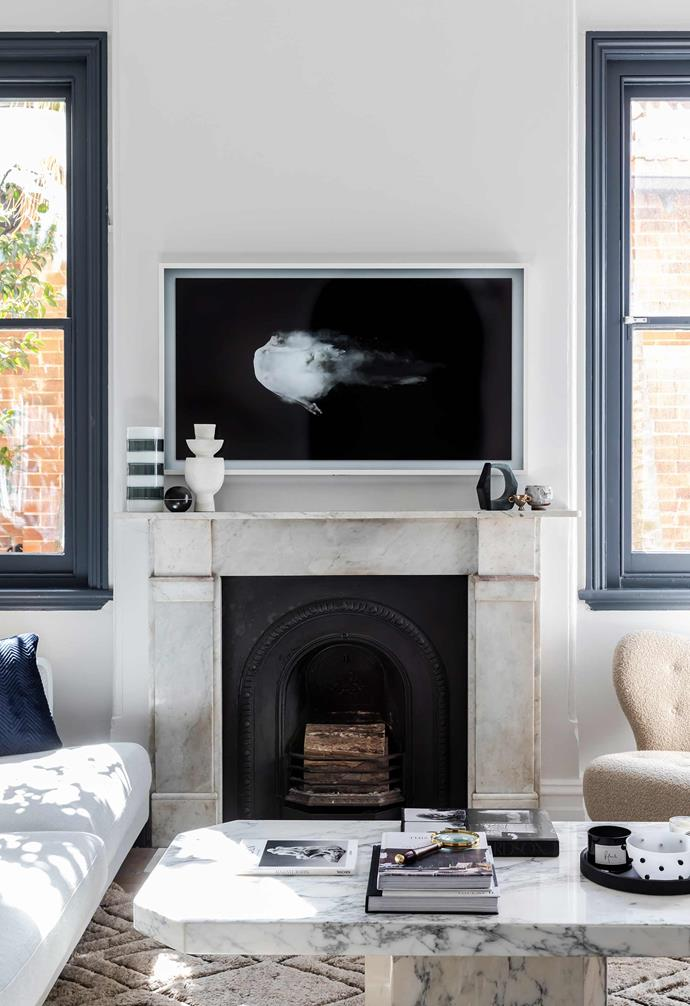 "[Interior designer Jillian Dinkel](https://www.homestolove.com.au/jillian-dinkel-home-21167|target=""_blank"") opted for mounting her television on the wall above the fireplace in her home, where it takes pride of place."