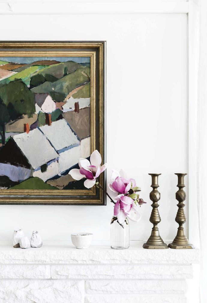 **Living area** Ceramics by Alison Fraser from Slab + Slub and Cécile Daladier top the fireplace, beneath an artwork by an unknown Scandinavian artist.