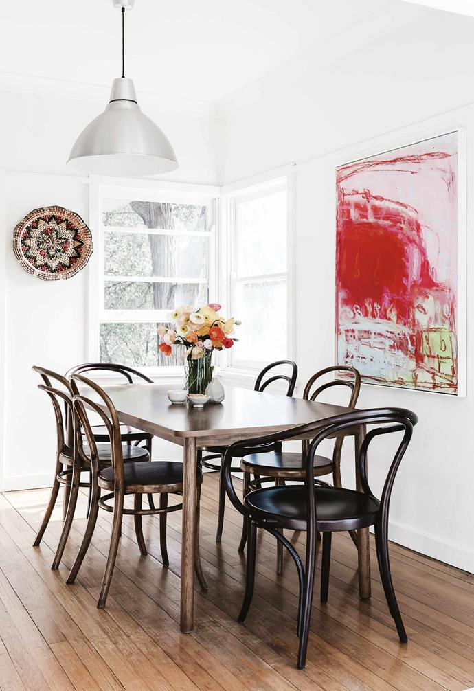 """**Dining area** An original Olivier Rasir artwork dominates this space, which is grounded by a Nomi dining table, [Thonet](https://thonet.com.au/