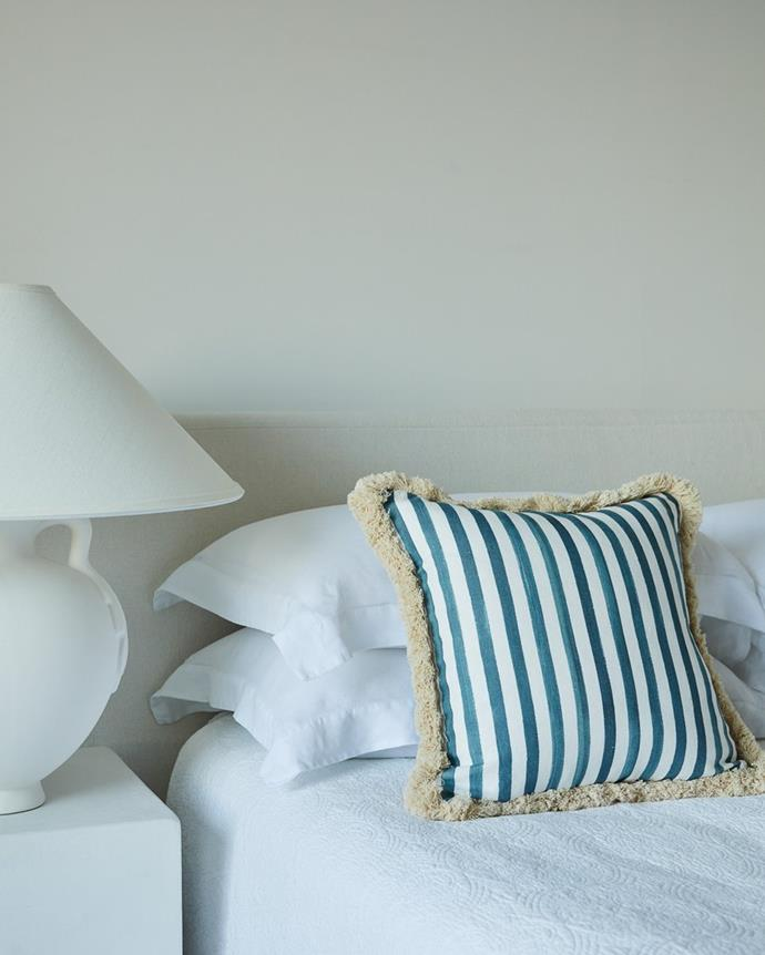 """Blue stripes cushion with brush fringe, $260, [Lucy Montgomery Collection](https://lucymontgomery.com/products/stripes