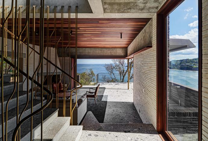 The decorative brass balustrade by Caroline Casey references the topography of the headlands outside. Grigio Perla limestone flooring, JP Natural Stone (throughout). Ceiling clad in bulletwood. San Selmo Corso bricks in Brenta Raw, Austral Bricks.
