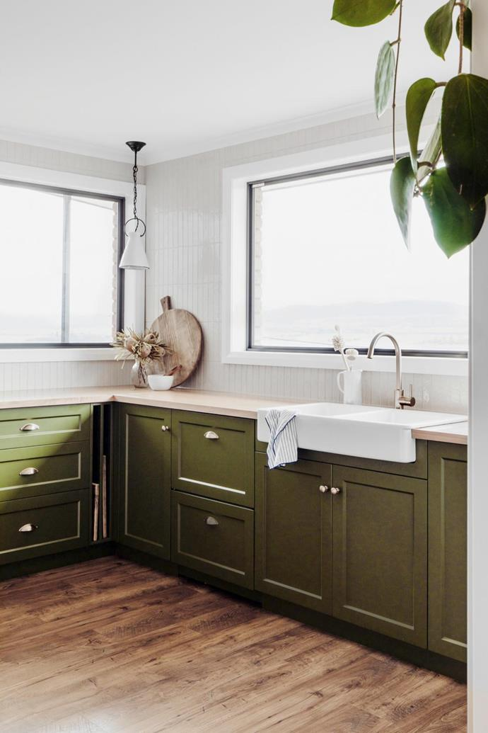 """Tying this kitchen's scheme together is the Shaker-style joinery, painted jungle green. """"We explored various tones of green before settling on this one, Dulux Amazon Depths, which works beautifully with the timber benchtops,"""" says designer Lydia Maskiel."""