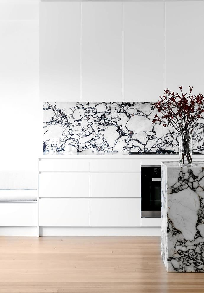 """A luxurious 'plinth' of marble is the centrepiece of this timeless, simple and sophisticated kitchen. The owners """"wanted a modern, fresh, inviting and timeless design,"""" says Chris Ruffe, director of Bondi Kitchens who revamped the space in collaboration with The Interior Collective."""