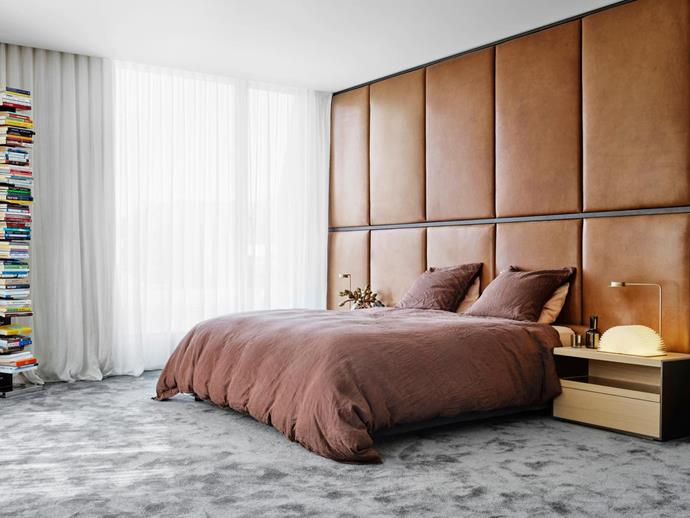 The master bedroom's bedhead by Flack Studio is crafted in Verona leather in Nutmeg from Contemporary Leathers. B&B Italia 'Surface' bedside tables from Space and Wästberg 'Chipperfield' lamps from Euroluce. Opinion Ciatti 'Ptolomeo' bookcase.
