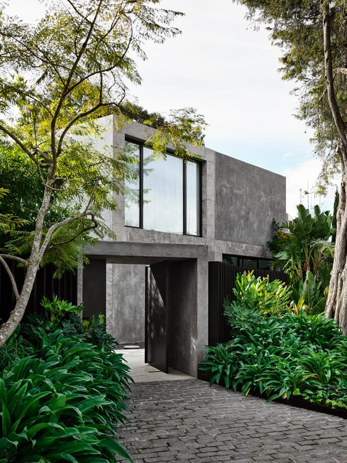A garden landscaped by Rupert Baynes envelops the modernist exterior, which speaks to the 1950s architectural vernacular of this leafy Melbourne suburb.