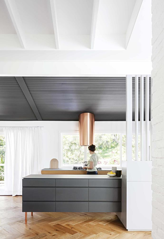 """**Kitchen** """"Alison added a clever concealed section for dishes and the [kitchen clutter](https://www.homestolove.com.au/tricks-to-declutter-your-kitchen-13665