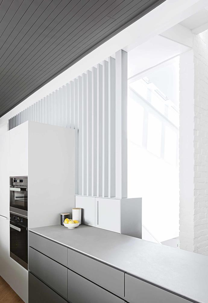 **Details** The battens in the kitchen space help to flood the space with natural light from the void above the staircase.