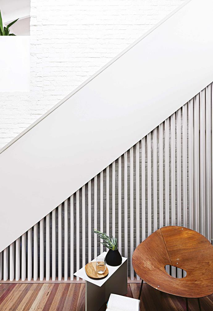 **Details** The slatted effect on the staircase ties into the kitchen detail and lightens up the solid form.