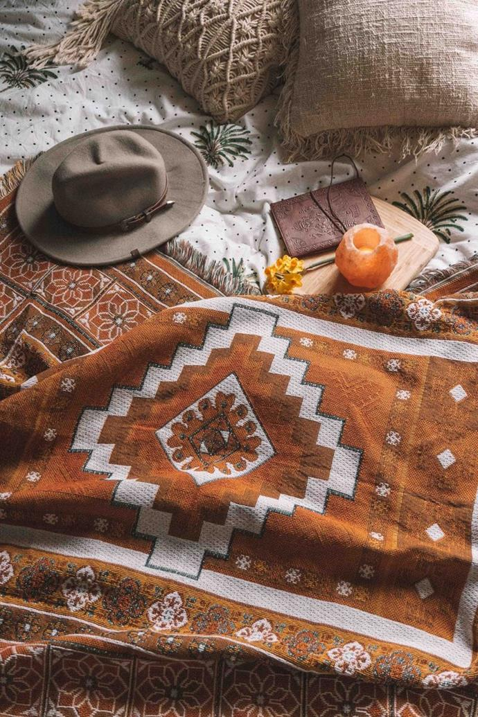"""The Sunrise Rug, $158, [Salty Aura](https://saltyaura.com/collections/rugs/products/the-sunrise-rug