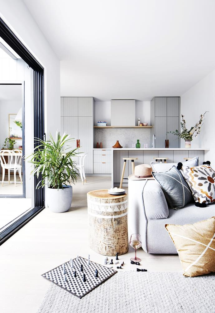 "A grey pot is home to a striking palm plant in the heart of the open-plan kitchen, living and dining space in this [coastal holiday home](https://www.homestolove.com.au/coastal-holiday-home-19311|target=""_blank"")."