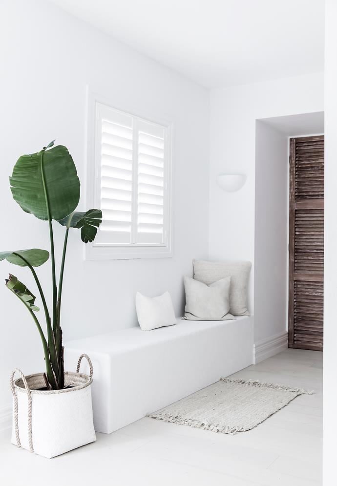 "In [Lana Taylor of Three Birds Renovations' Mediterranean-style home](https://www.homestolove.com.au/lana-taylors-modern-mediterranean-style-home-6378|target=""_blank""), a beautiful plant has been carefully placed at the entryway to contrast with the stark all-white palette."