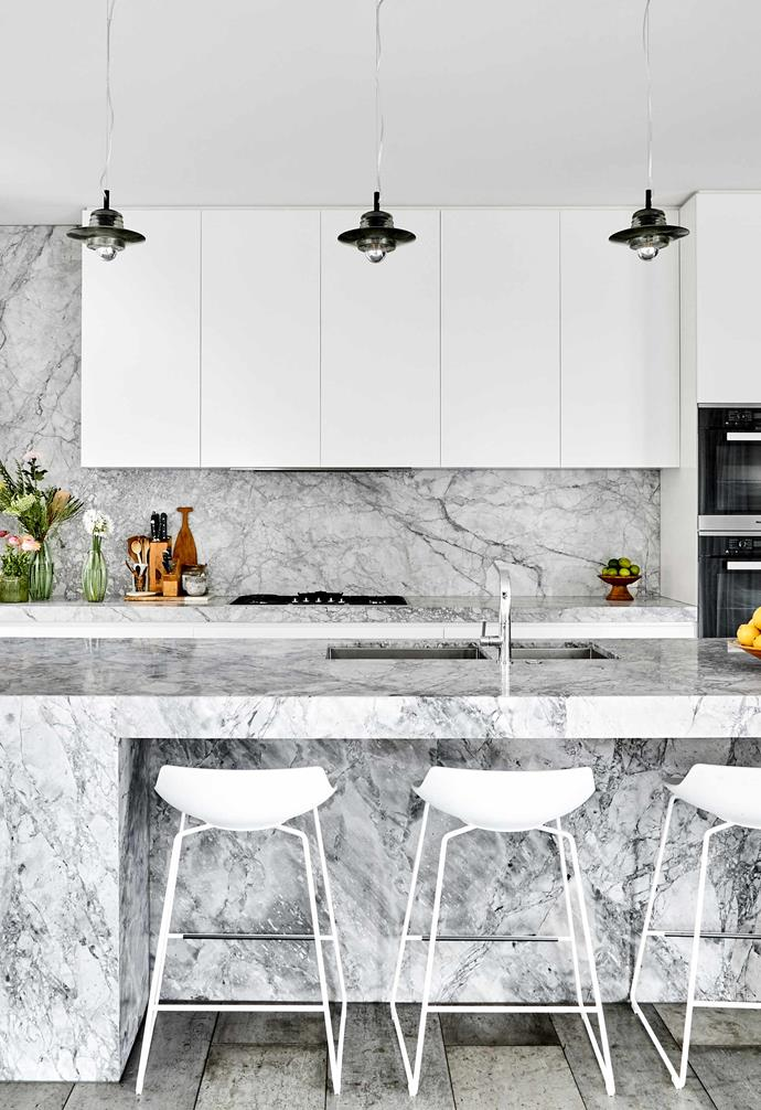 """**Kitchen** Custom white cabinetry and stainless-steel appliances are the perfect backdrop for the high-impact marble island and splashback. MDF Italia bar stools from [Hub Furniture](http://www.hubfurniture.com.au/