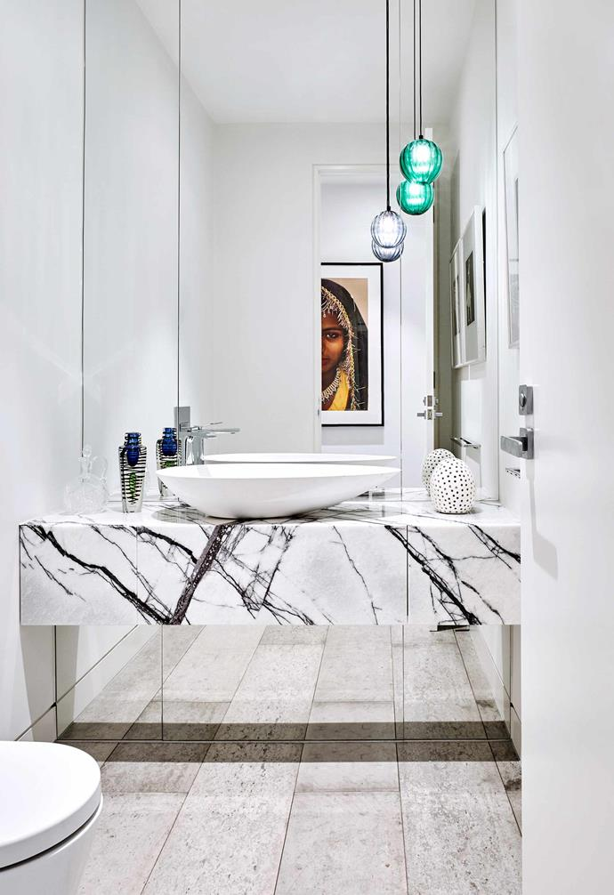 """**Powder room** A floor-to-ceiling mirrored wall makes the small space feel much larger than it actually is. Suspended glass lights, [Mark Douglass Design](https://www.markdouglassdesign.com/