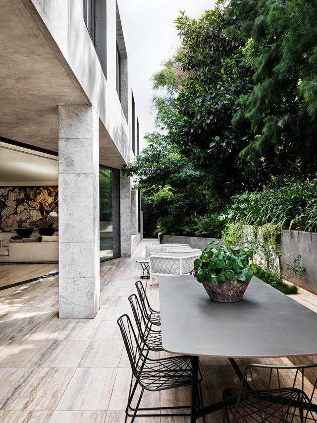 "This [new home's](https://www.homestolove.com.au/modernist-mansion-toorak-21774|target=""_blank"") innate sense of gravitas and material sincerity stems from the local architecture and the family who live here. Travertine floor tiles leisurely stretch out into the expansive open-air entertaining area."