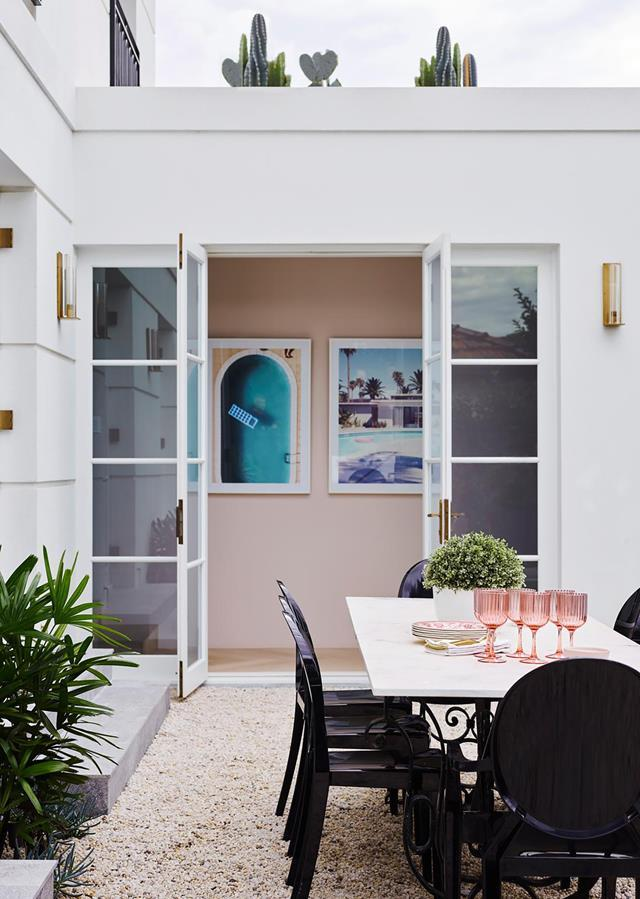 "A youthful romance with pink and grey informed the subtle palette for this [sophisticated home](https://www.homestolove.com.au/sophisticated-yet-youthful-art-deco-home-21152|target=""_blank"") which offers a welcoming embrace in its simply elegant curves. French doors create a connection with the outside while being true to the deco era."