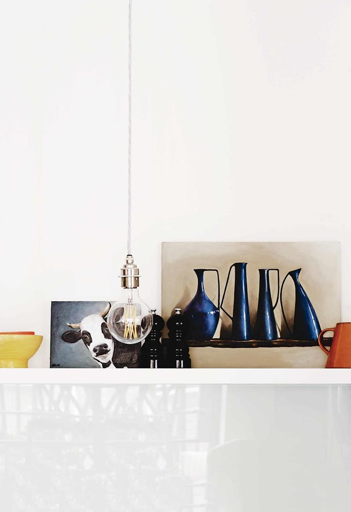 "**Kitchen** The cow and jug artworks are by owner and artist Stephanie Burgess. The pendant lights throughout the home are from [Edison Light Globes](https://edisonlightglobes.com/Shop/|target=""_blank""