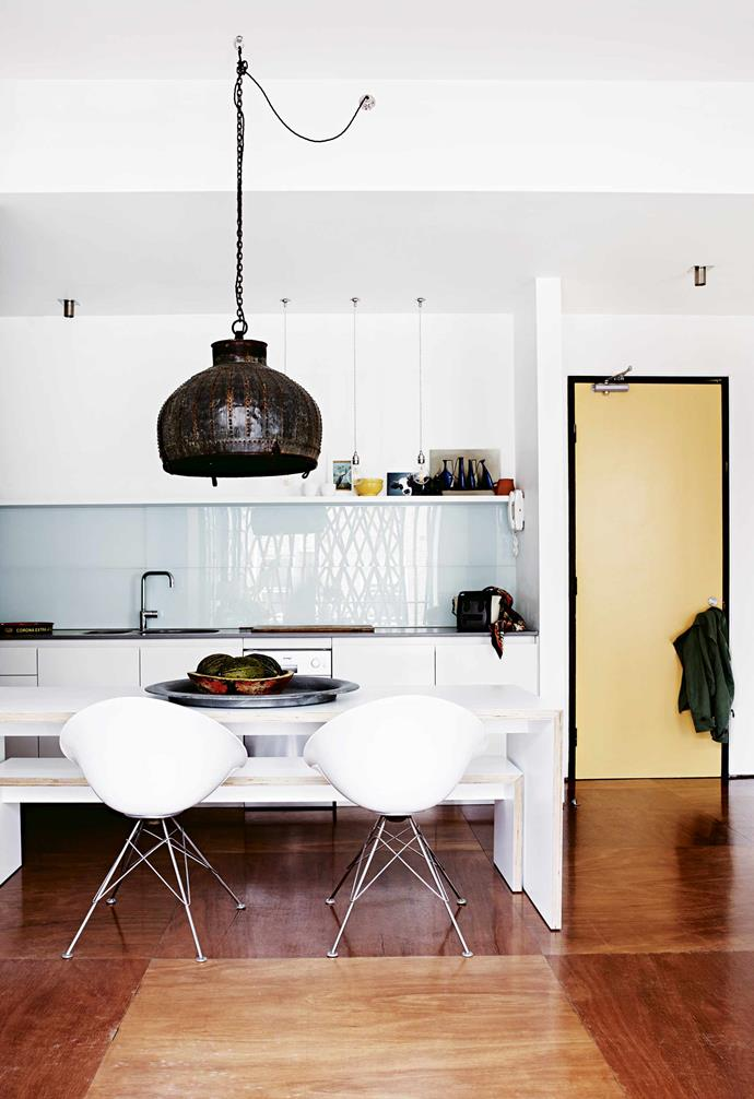 "**Dining area** The [open-plan living space](https://www.homestolove.com.au/20-best-open-plan-living-designs-17877|target=""_blank"") incorporates the kitchen and dining area as well as the entrance, with the front door painted in a sunny yellow. An old Turkish water vessel from [Elements I Love](https://elementsilove.com/