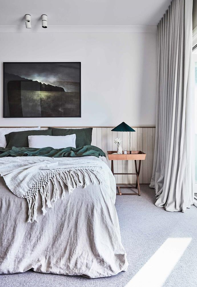 "In [Kristy McGregor's beautiful Bondi abode](https://www.homestolove.com.au/kristy-mcgregor-house-21306|target=""_blank""), a chic bedside table plays host to a statement table lamp and vase to create a dreamy vignette."
