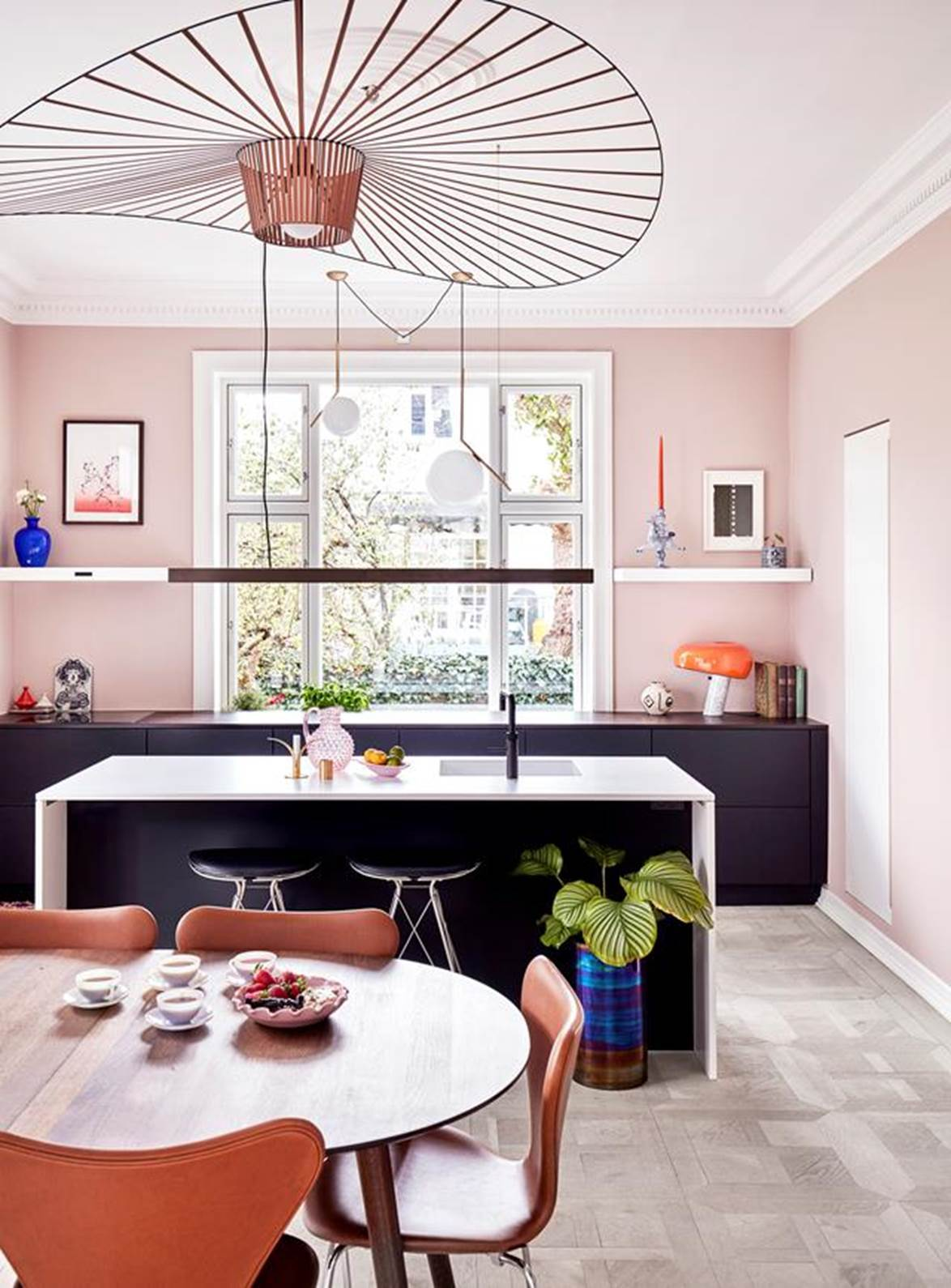 """A carefully chosen colour palette of pale pink, orange and deep blue are splashed throughout this charming kitchen in an [eclectic apartment](https://www.homestolove.com.au/colourful-eclectic-style-apartment-19184