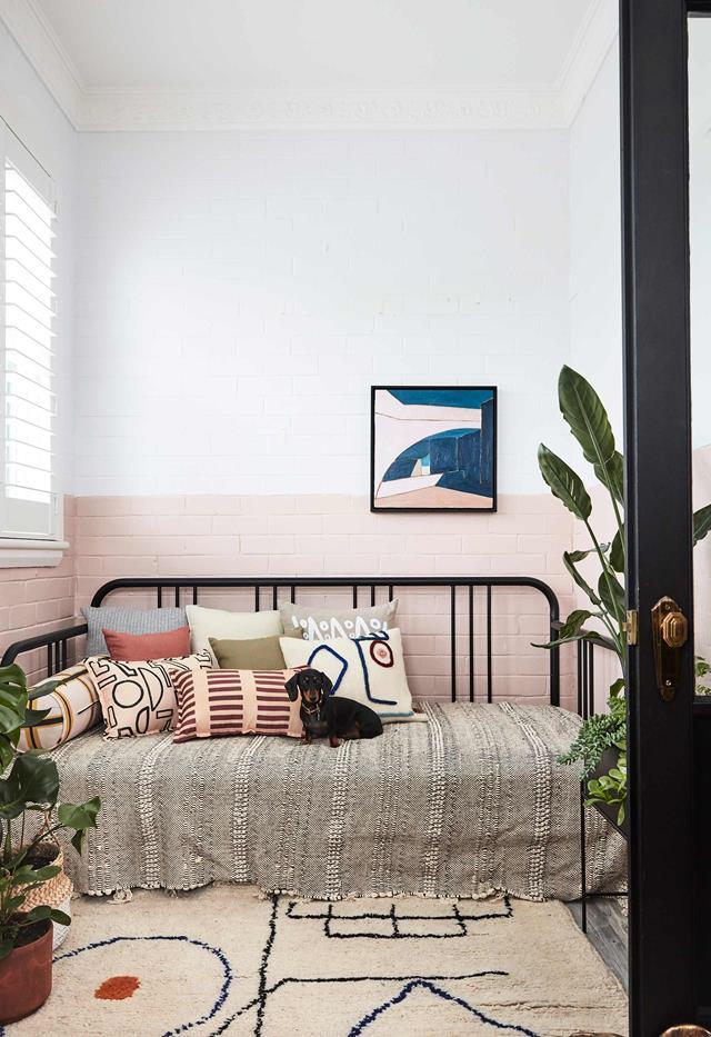 "Packed with storage and practical features, the compact, considered [home of interior architect Sophie Bowers](https://www.homestolove.com.au/small-apartment-design-ideas-20593|target=""_blank"") is an absolute treat. Sophie has transformed the compact sunroom into a cosy nook styled with cushions from LRNCE and Annie Coop."