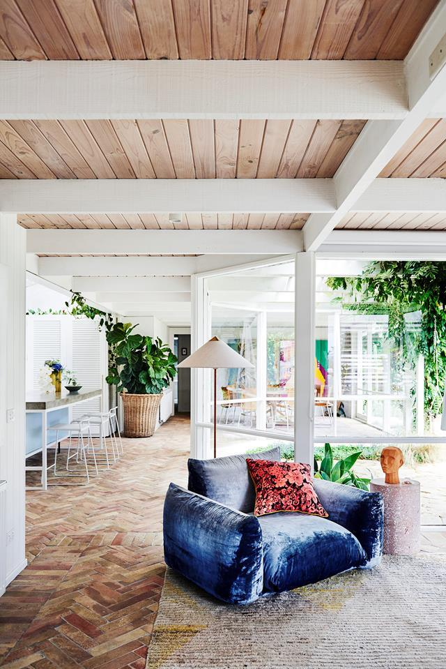 "This [playful house](https://www.homestolove.com.au/prudence-olivieri-home-21346|target=""_blank""), which owner Prudence describes as ""mid-century modern inspired"" is as refined and contemporary as it is joyful. The home is brought to life with a collection of art, a mix of her own works and pieces she and partner Damian have collected throughout their relationship."