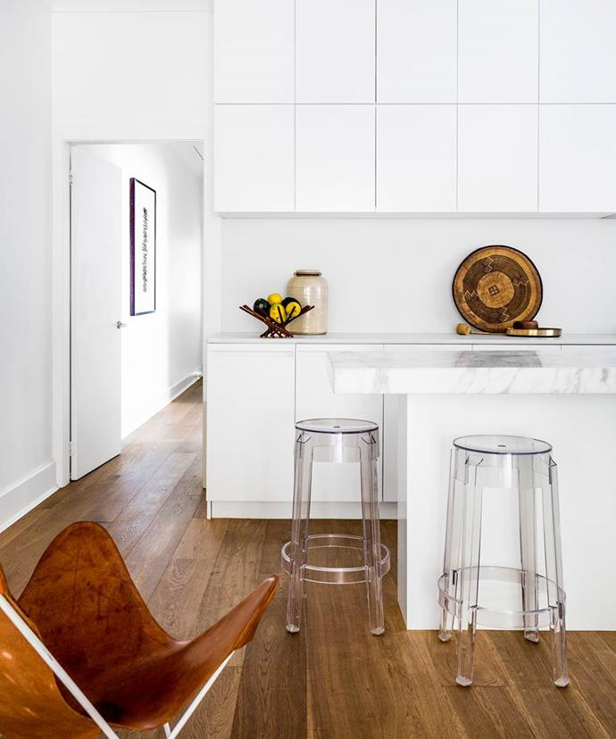 """Materials, such as white cabinetry and marble, were chosen to reflect light in the kitchen of this [semi in Bondi Beach](https://www.homestolove.com.au/gallery-romy-alwills-budget-conscious-renovation-1963