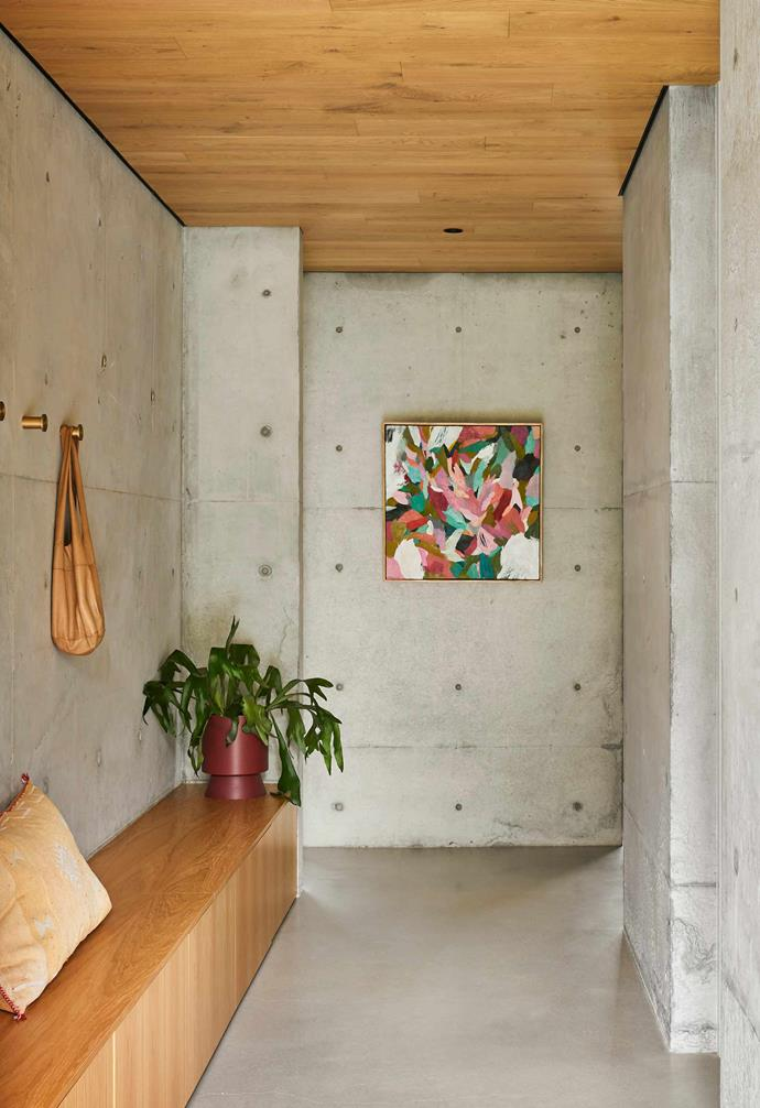 """**Entry** Built-in seating is decorated with a Lightly planter and cushion from [Rigby's Homewares](https://rigbys.com.au/