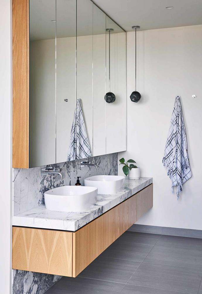 """**Ensuite** The palette of the downstairs powder room is carried through to this bathroom. Custom cabinetry and built-in mirrors house basins and tapware from [Reece](https://www.reece.com.au/