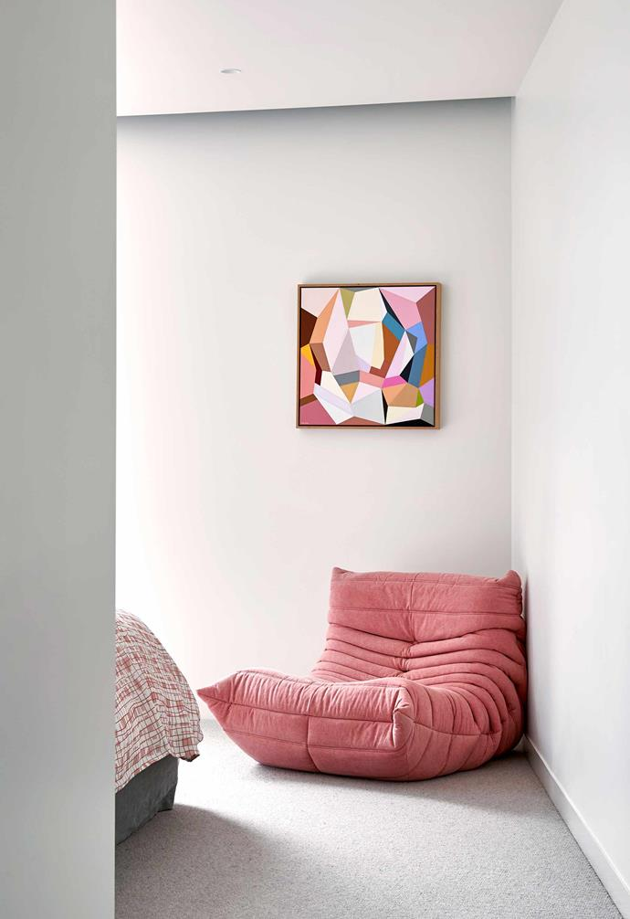 **Main bedroom** A dusty-pink Togo chair sits under an abstract work by artist Susie Monte.