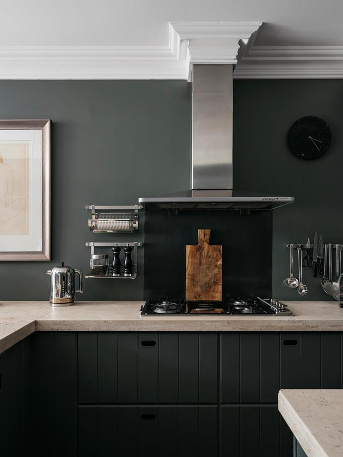 """The kitchen joinery is painted in the same deep green (Cliffhanger by Resene) as the walls, which matches the dark tones and [theatrical décor of this sultry Sydney home](https://www.homestolove.com.au/dark-interior-design-20573