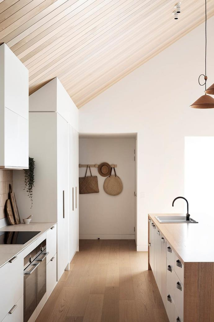 """Leather pulls and handles are just one of the beautiful and laid back aspects of this timber inspired kitchen in this [coastal home on the Great Ocean Road](https://www.homestolove.com.au/scandinavian-style-beach-house-20995