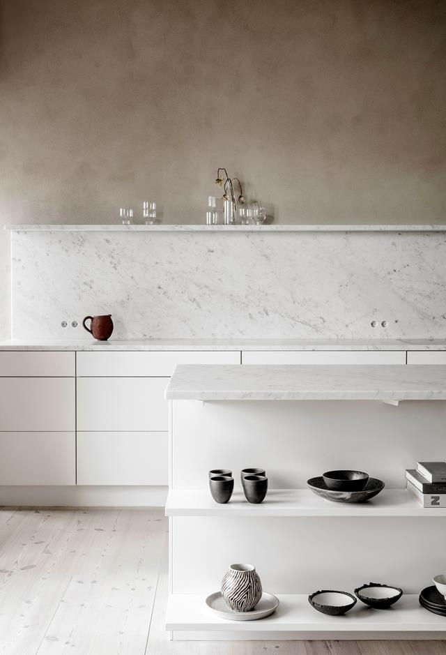 """A collection of Danish and Japanese vessels, bowls and glasses adorn the beautifully minimal kitchen of this [industrial style home in a 17th-century Copenhagen](https://www.homestolove.com.au/exposed-timber-beams-20584
