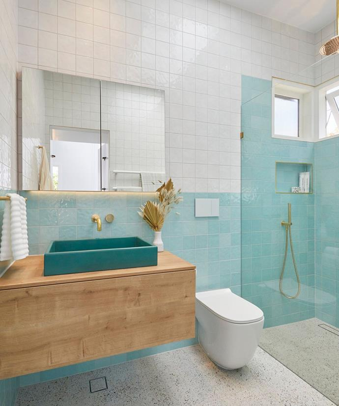"""**The Block 2020: Jimmy and Tam** <br></br>  On week two of The Block in 2020, Brisbane couple Jimmy and Tam delivered a stunning [guest ensuite](https://www.homestolove.com.au/the-block-2020-guest-ensuite-reveals-21798 target=""""_blank"""") that all of the judges loved. The space, which featured turquoise blue tiles, terrazzo floor tiles and brass tapware, was described by Darren as a """"public pool change room"""" with a """"retro, yesteryear, childhood charm."""""""