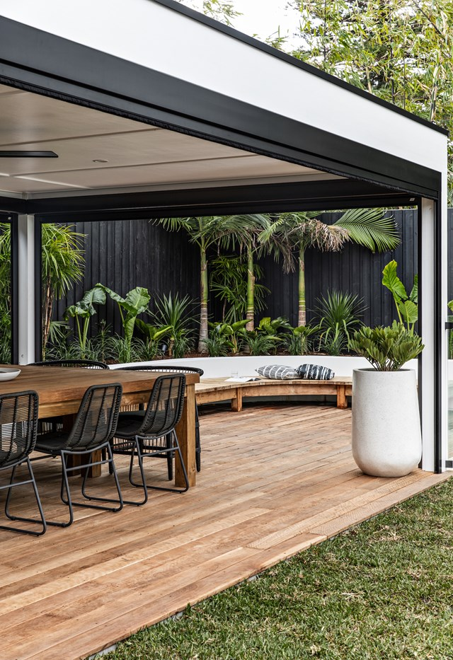The covered deck area is the perfect spot to entertain year round.