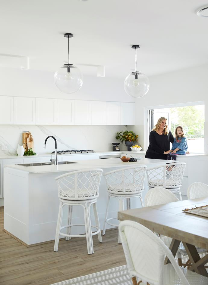 "This is a great example of a modern, coastal Hamptons look,"" says Natalee of the crisp white kitchen, lined with Polytec 'Berrilee' cabinetry in Ultra White Matt. ""The slight Shaker profile gives it