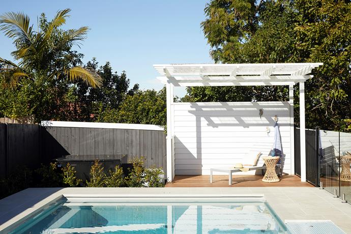 """Beyond choosing a great builder, I think investing in good landscaping was one of the best decisions we made,"" says Robyn about Ballast Landscape, who built a cabana out of James Hardie cladding to provide a sunlit spot for sitting by the pool. ""Our block was difficult because it sloped in two directions, but the landscaper transformed everything – we just have to wait for our plants to grow!"" Ezarri glass mosaic tiles from Europe Imports line the self-cleaning pool
