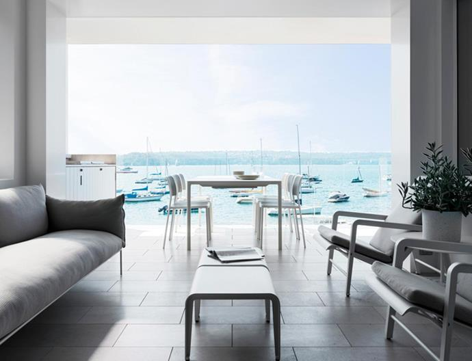 Paola Lenti 'Kabà' sofa from Moebel. Tribù 'Mirthe' armchairs and coffee tables from Cosh Living. Travertine flooring in Silver Ash from Granite & Marble Works extends onto the terrace where Kartell 'Audrey' chairs from Space surround an Emu 'Terramare' outdoor dining table from Ke-Zu.