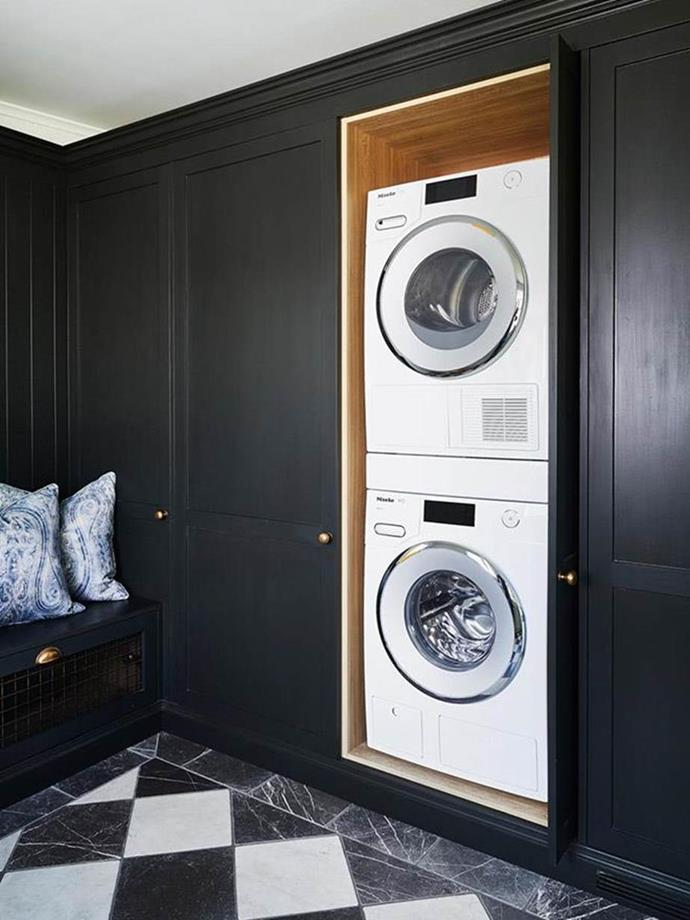 "The Miele washing machine and dryer are tucked neatly into custom joinery in this stunning laundry. The neighbouring bench seat is an exceptionally stylish spot for kicking off the RM's after a long day on the farm in [Steve Cordony's luxe kitchen](https://www.homestolove.com.au/steve-cordonys-luxe-country-kitchen-at-rosedale-farm-21256|target=""_blank"")."