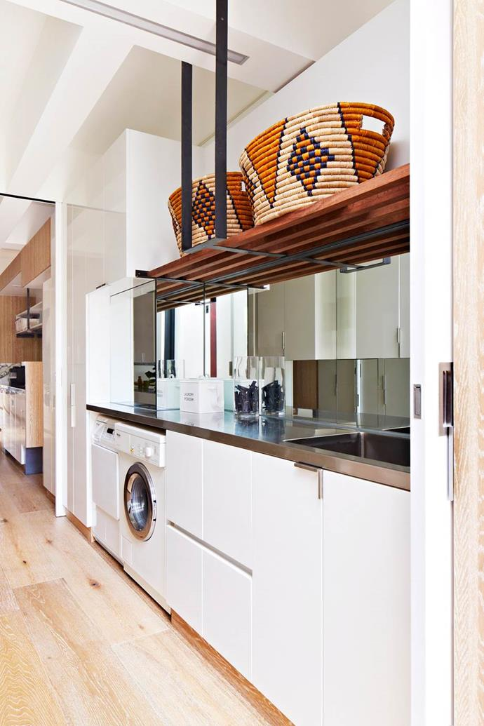 "A galley-style, mirrored laundry is concealed alongside the scullery in this open-plan Melbourne home designed by architecture firm [Multiplicity](https://www.multiplicity.com.au/?utm_campaign=supplier|target=""_blank""
