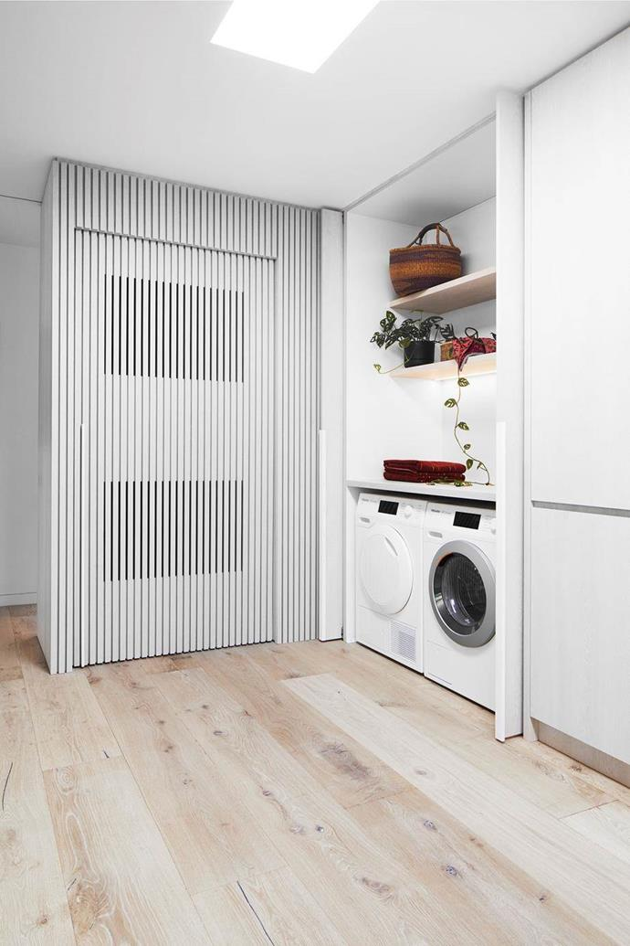 "The compact European laundry in this [garage turned guesthouse](https://www.homestolove.com.au/converted-garage-guesthouse-21350|target=""_blank"") is cleverly integrated into cupboard space, turning an empty hallway into a useful space, with the addition of a pot plant to add decor flavour."