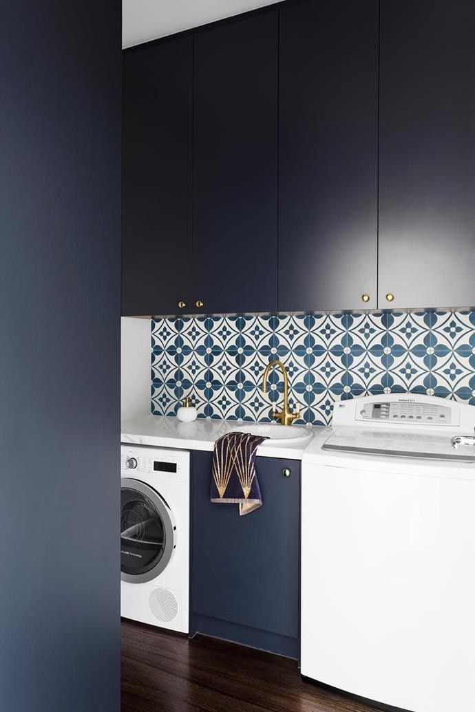 This laundries' statement tiles establish a mood and give the utilitarian space a polished, luxurious edge, while a touch of glamour is bought in the form of a brass or copper tap and door handles – warm metallics and moody hues are a match made in heaven.