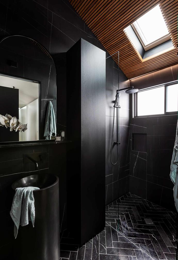 "**Ensuite** This adult space is dramatically decorated to evoke a hotel suite, with a custom mirror, pedestal sink by [Apaiser](https://www.apaiser.com/|target=""_blank""